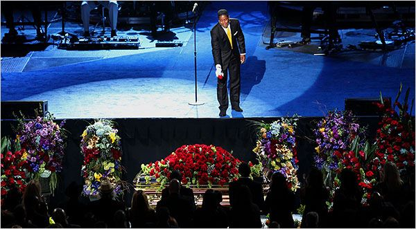Jermaine Jackson tossed a rose after singing in front of his brother's casket during the memorial service on Tuesday. Source: Monica Almeida/The New York Times