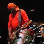 Ernie Isley playing guitar onstage