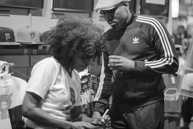 Sy Smith signing album at Soul Village/Moods Music for fan, friend and recording soul artist, Anthony David.
