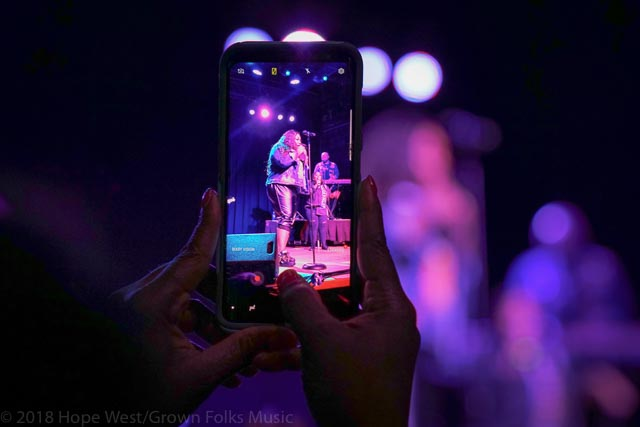 A fan capturing a moment of Tasha Cobbs Leonard performing on the Revival Tour in Atlanta
