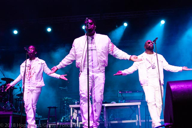 Boyz II Men performing on stage at the State Farm Arena for the
