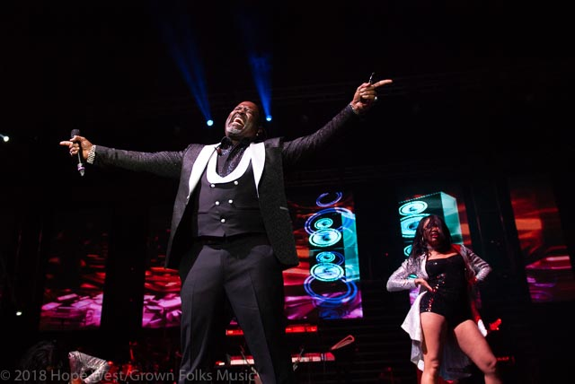 Johnny Gill performing on stage at the State Farm Arena for the