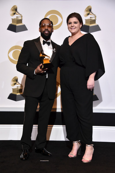 PJ Morton and YEBBA posing on the Grammy Red Carpet after winning Best Traditional R&B Performance.