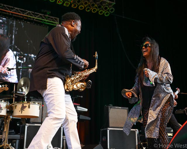 Sheila E. with saxophonist performing at Kiss 104.1 Flashback Festival