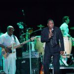 Eric Grant of The O'Jays performing onstage at Chastain Park